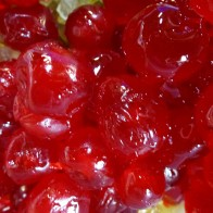 Don's Xmas. cake glazed cherries. Rum is used to macerate the cut up fruit before it is mixed into the cake batter.©Gail Harker