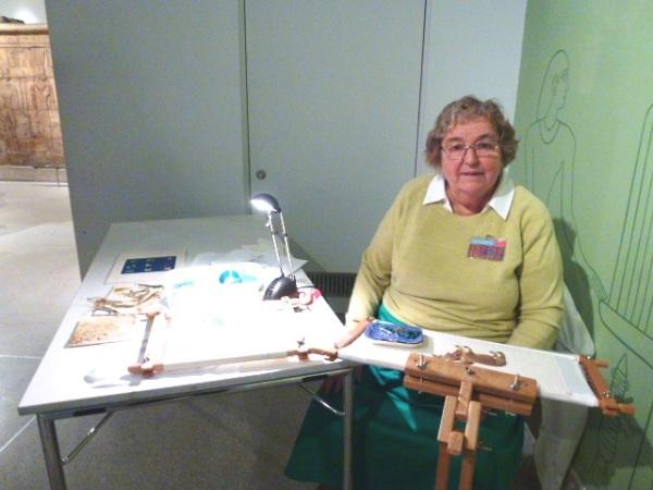 embroiderer demonstrating goldwork
