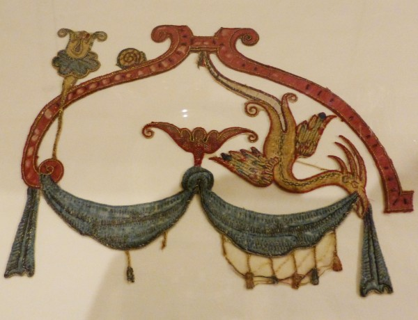 embroidered grotesque motifs