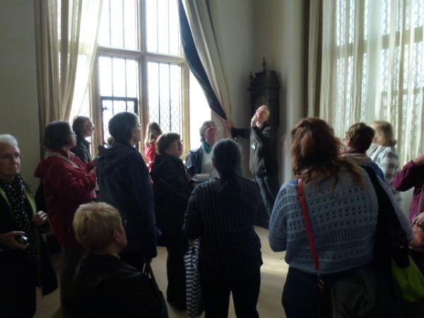 examining the tall windows