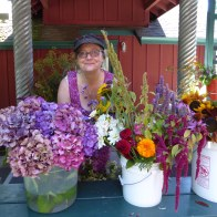 Susan Lenarz arranges flowers outside the front door