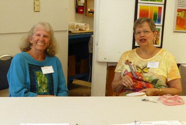 Nancy and Linda greet visitors