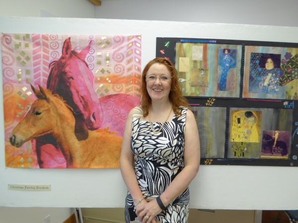 Christina Erickson in front of her © artwork
