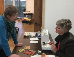 Gail Harker consulting with Karen Nelson about goldwork by machine.