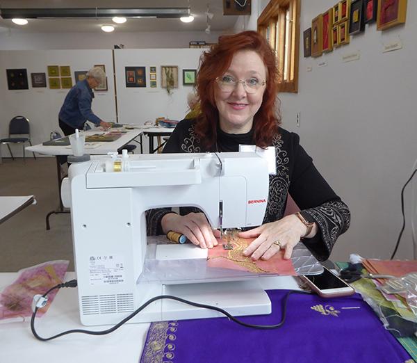 Christina Fairley Erickson demonstrating machine Goldwork stitching.